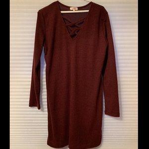 Maroon long sleeved dress.
